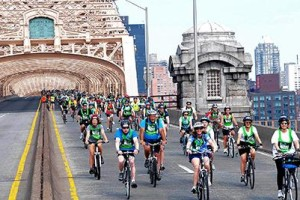 Cyclists ride down the Queensboro Bridge during the Five Boro Bike Tour. The 42-mile tour began 33 years ago with 250 participants,a nd this year about 32,000 riders participated. Photo by Steven Malecki